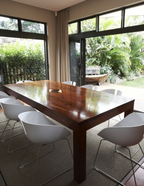 solid-timber-table-with-patricia-urquiola-chairs