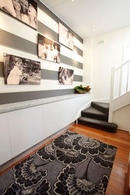 Custom Joinery and rug with feature wallpapered photo gallery